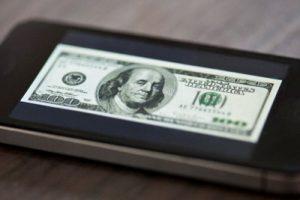 image of 100 dollar bill on smartphone