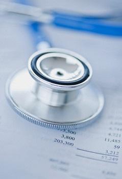 Stethoscope on doctor's bill